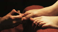 Hands painting toenails Stock Footage