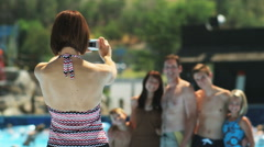 family taking a photo at a water park - stock footage