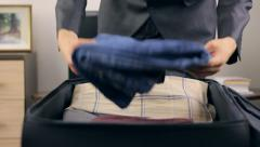 Man packing his suitcase  - stock footage