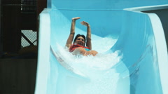 Woman on a waterslide Stock Footage