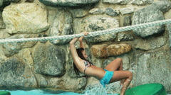Girls on a rope bridge at a water park Stock Footage