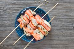 Smoked salmon and grilled artichoke Stock Photos
