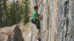 Rock climber on a wall Stock Footage