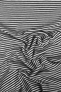 Striped wrinkled black and white zebra fabric cloth background Kuvituskuvat
