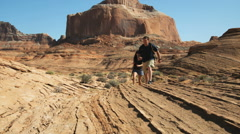 Couple hiking in the desert Stock Footage