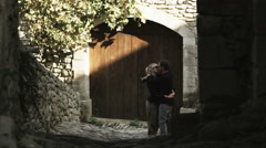 Couple kissing on a European street Stock Footage