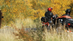 Motorcyclists going around a bend Stock Footage