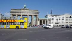 Brandenburg Gate with the passing sightseeing bus Stock Footage