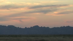 Badlands Western Region Summer Dawn Orange Sky Pan Stock Footage