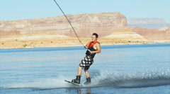 Wake boarder jumping the wake Stock Footage