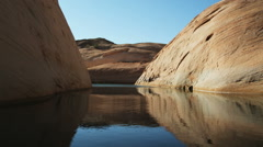 following a winding desert waterway - stock footage