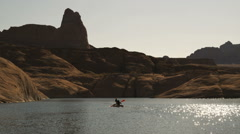 Two kayakers on a desert lake Stock Footage