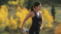 Woman stretching before a run Stock Footage