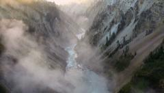 Dramatic view of Lower Falls waterfall in Yellowstone Stock Footage