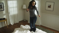 woman jumping on the bed - stock footage