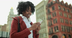 African American black woman in city texting on smart phone cellphone 4k - stock footage