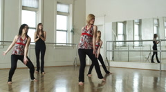 Dancers in a dance studio with instructor Stock Footage