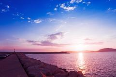 Pink sunset in alghero Stock Photos