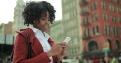 African American black woman in city texting on cellphone 4k - stock footage