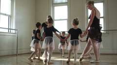 Young ballerinas in a dance studio in a circle Stock Footage