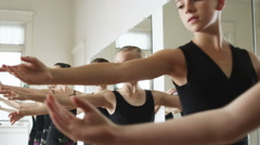 Young ballerinas in a row Stock Footage