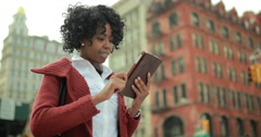 African American black woman in city using tablet pc computer 4k - stock footage