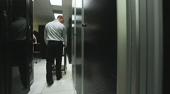 Man in a server room Stock Footage
