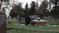 Mother and children at a funeral Stock Footage