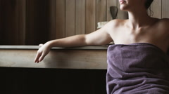 Woman in a sauna Stock Footage