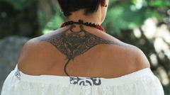 Pacific islander woman with a tattoo Stock Footage
