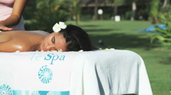 Woman getting a massage on the beach Stock Footage