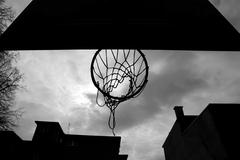 close up of basketball hoop from below - stock photo