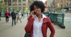 African American black woman in city walking talking on cellphone 4k Stock Footage