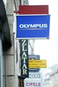 olympus shop sign in city centre - stock photo