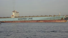 Blue empty, unloaded merchant haul container ship crossing Bosporus Bridge Stock Footage