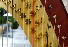 Part of musical instrument called harp Stock Photos