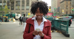 African American black woman in city walking texting smart phone cellphone 4k - stock footage