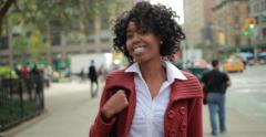African American black woman in city walking smiling on street 4k Stock Footage