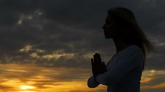 woman deep in meditation at the sunset: yoga, spiritual, religion - stock footage