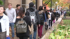Campus life diverse college and university students walking to classes Stock Footage