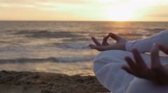 Stock Video Footage of woman having meditation at the sunset: practicing yoga near the sea