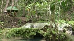 Spend Under Hut Besides Waterfall Stock Footage