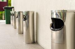 Garbage bin of steel stainless outside a building Stock Photos