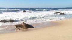 Waves break onto a pristine beach Stock Footage