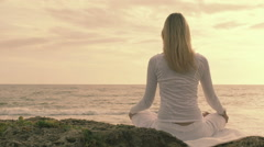 Practice of yoga on the beach: woman having meditation moments, spiritual time Stock Footage