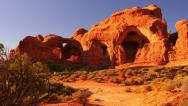 Stock Video Footage of 4K Arches 13 Windows Section Sunset Double Arch Utah USA