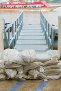White sandbags for flood defense Stock Photos