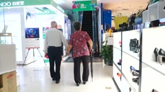 An elderly couple went to the mall, in Shenzhen, China Stock Footage