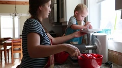 Expecting mother and toddler juice fresh tomatos Stock Footage