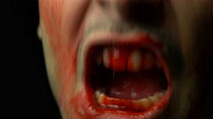 4K Biting Zombie Horror Blood Mouth Closeup - stock footage